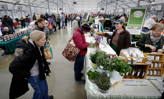 The Milwaukee Winter Farmers Market at the Mitchell Park Domes, as seen in 2016. It resumes Nov. 7, this year with mask requirements and about half as many vendors in a given week to account for social distancing.
