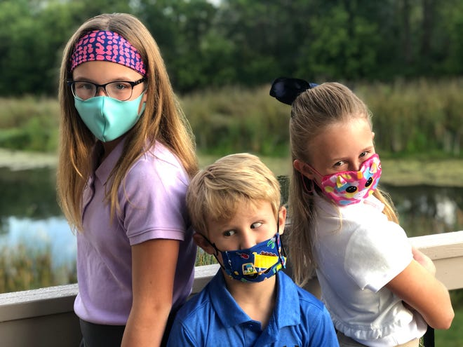 Kayla, Carson and Kendall Ford prepare for their first day of in-person school during the coronavirus pandemic.