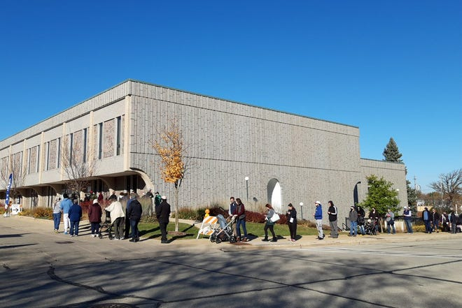 Voters lined up at West Allis City Hall to cast their ballots on Election Day, November 3, 2020. The city's common council members recently discussed the idea of changing the way West Allis' aldermanic districts are structured, but the proposal received little support.