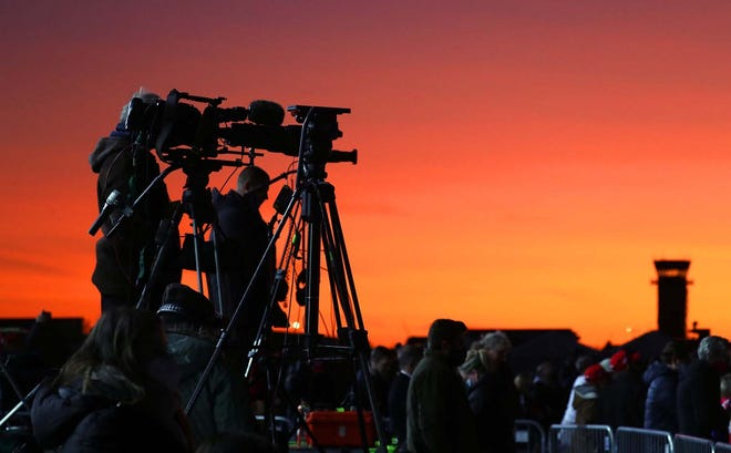 The sun set behind TV cameras that were set up before President Donald Trump spoke at a campaign rally at Kenosha Regional Airport on Monday.