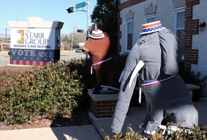 Since 1983, the two lion statues outside of The Starr Group in Greenfield have been dressed up for just about any and every occasion, from holidays to game days.