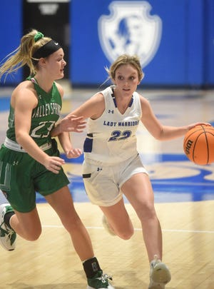 Cotter's Kaylee Crownover is defended by Valley Springs' Whitney Coffelt on Monday night at Cotter.