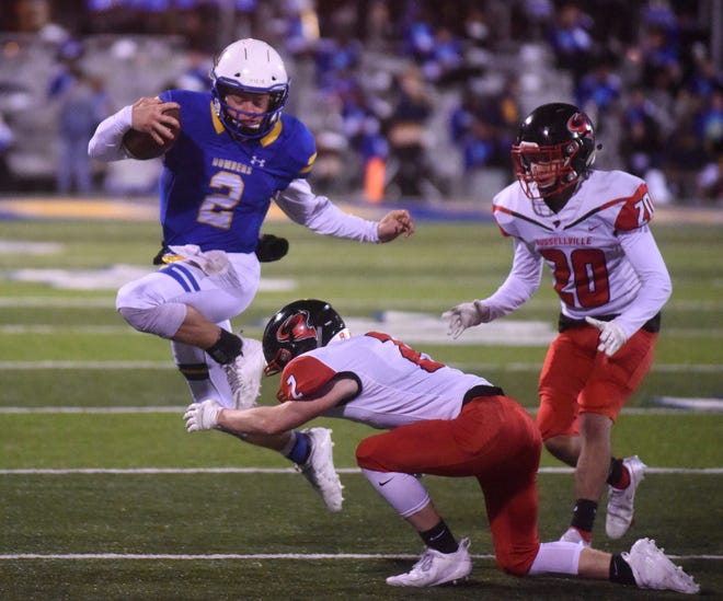 Mountain Home quarterback Bryce McKay evades a Russellville defender during the Bombers' 24-7 victory last week.