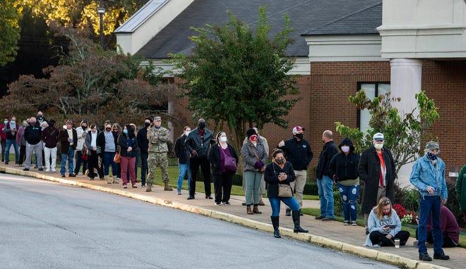 Voters stand in line to vote at Dalraida Church of Christ in Montgomery, Ala., on Election Day Tuesday November 3, 2020.