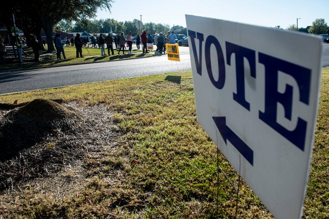 Voters line up at Vaughn Park Church of Chirst in Montgomery, Ala., on Tuesday, Nov. 3, 2020.