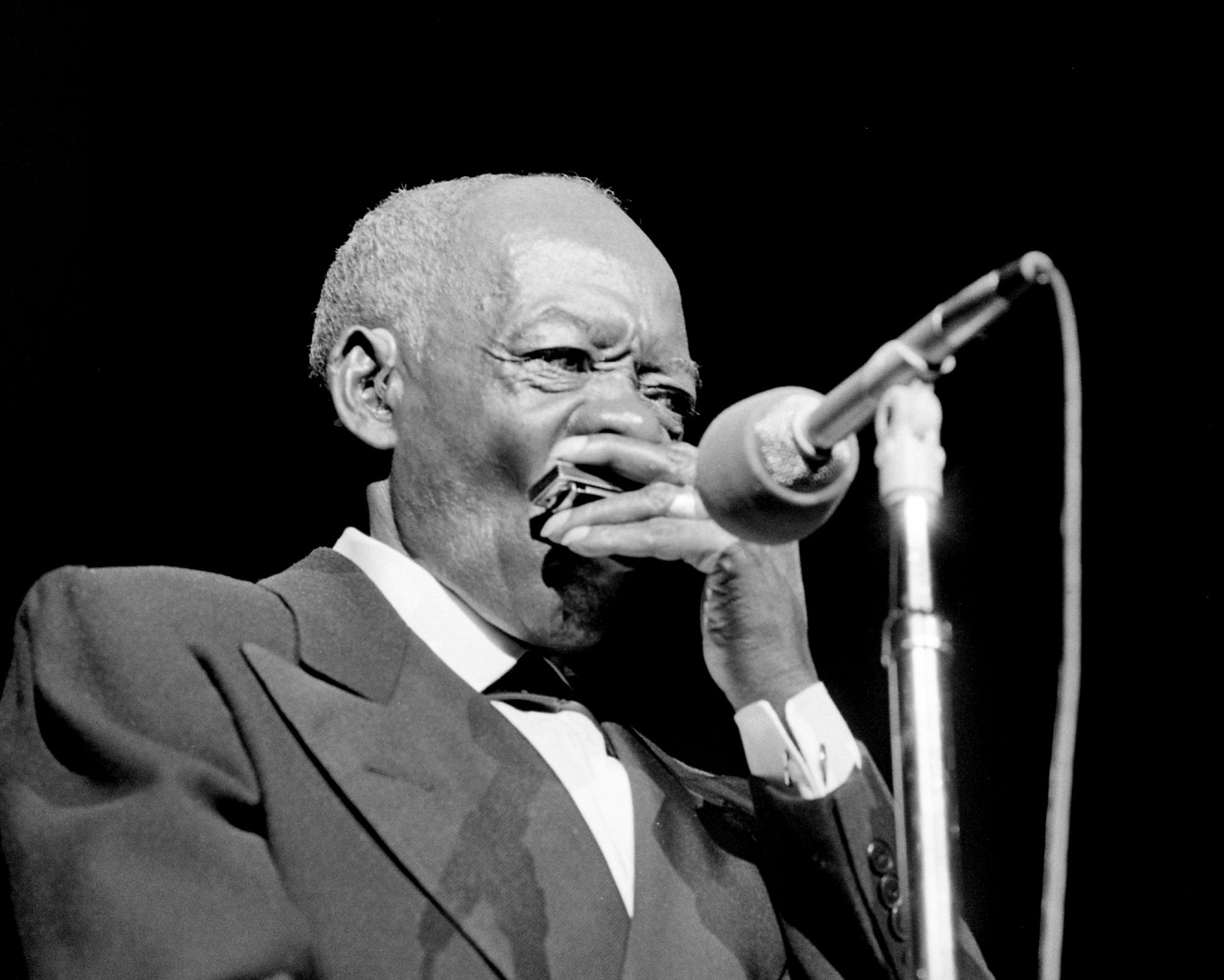 """Veteran harmonica player DeFord Bailey plays at the Grand Ole Opry House Dec. 14, 1974 with """"It Ain't Gonna Rain No More,"""" """"The Pan American Blues"""" and """"Fox Chase."""""""