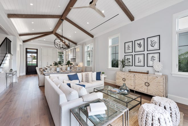 The interior design team of Christina Rosalia and Ashton Reams provided furnishings and light fixtures for interior design of a Coquina II model home located on Lot 8 in Mangrove Bay in Naples.