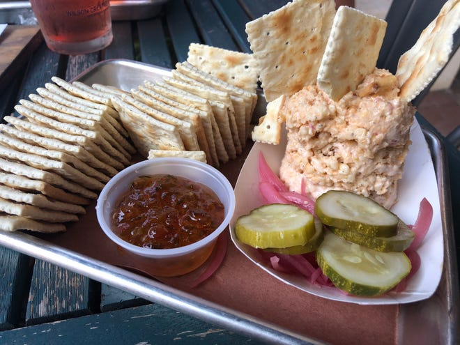 The cheese and crackers ($8) appetizer from Industry Beer and Barbecue in Naples comes with pepper jelly, pimento cheese, pickle chips and pickled onions, all house made, with a serving of classic saltines.