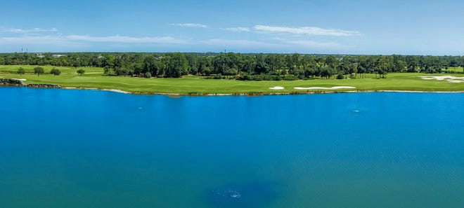The penthouses at Moorings Park Grande Lake offer panoramic lake and golf course views.