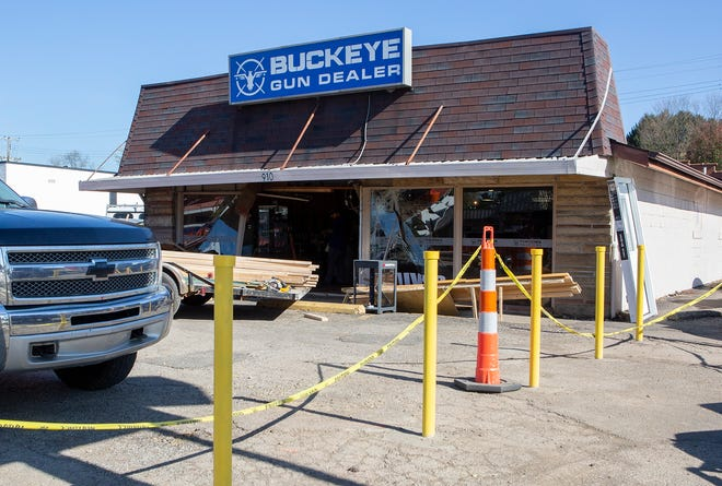"""A car drove into Buckeye Gun Dealer on 21st Street. According to a Facebook post from the company, the people who crashed the vehicle """"stole a lot, and did an incredible amount of damage."""""""