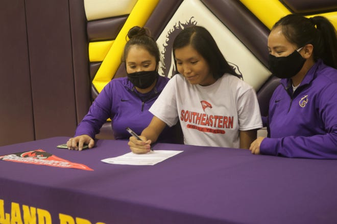 Kirtland Central's Tatyanah Benally signs her National Letter of Intent on Monday, Nov. 2, 2020 to continue her volleyball career at Southeastern Community College in West Burlington, Iowa.