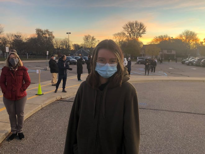 Gwen Pinger, 18, stands in line to vote in her first election on Tuesday, Nov. 3, 2020, at Pierce Elementary in Birmingham.