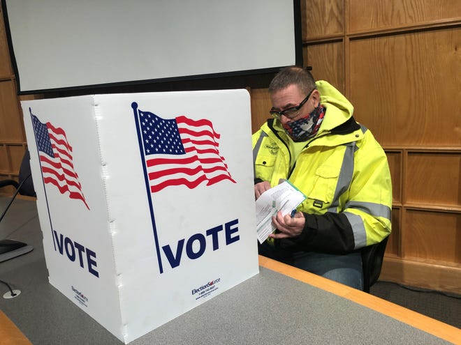 Mike Gibson, 44, voted for the first time in his life on Monday, Nov. 2, 2020. He cast his absentee ballot at the South Lyon municipal offices. On Nov. 2, 2021, voters will be able to elect three new South Lyon City Council members.