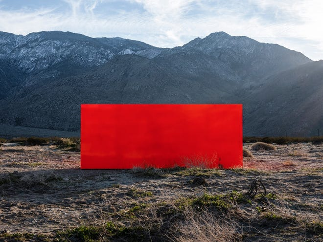 For Desert X 2019, Los Angeles-based artist Sterling Ruby created Specter, a fluorescent orange monolith that appeared as an apparition in the desert.