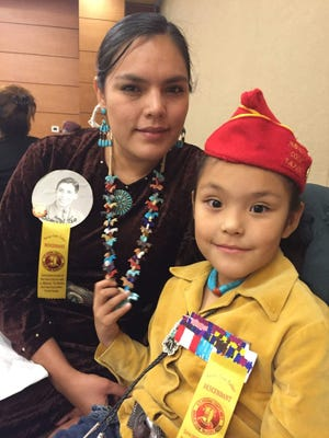 Danielle Goldtooth with her daughter Camille Atene attending the Navajo Code Talker Dinner in Farmington, New Mexico in April 2017 as descendants of her late great-grandfather Samuel Tso, a Code Talker who served with the U.S. Marines during World War II.