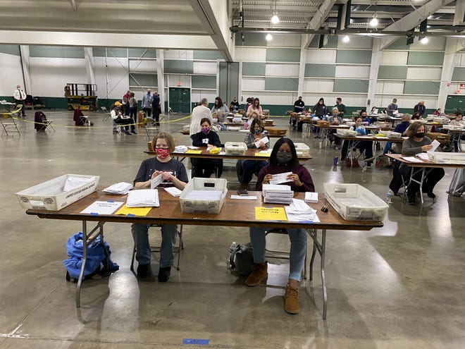 About 100 county employees processed mail-in ballots at the York Fairgrounds on Tuesday. Photo by Ed Mahon