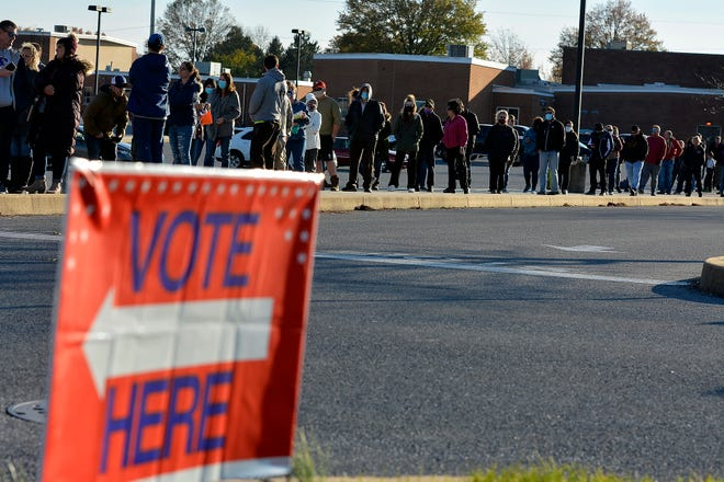 Hundreds wait in line to vote at Northeastern Middle School, Tuesday, November 3, 2020