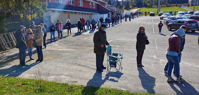 There's a long line to vote at Wisehaven Hall in Springettsbury Township on Tuesday, Nov. 3, 2020. John A. Pavoncello photo