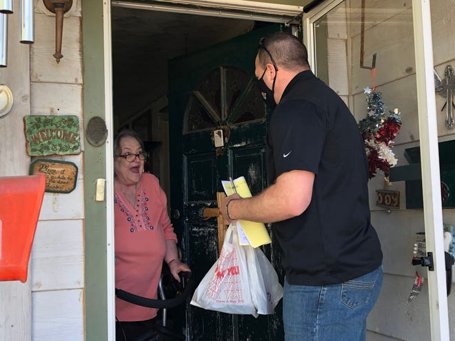 San Angelo resident, Joyce Kvapil, is ecstatic as Nick George of H-E-B tells her he is dropping of her Thanksgiving meal donated by Meals for the Elderly.
