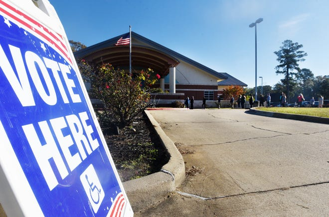 People wait in line to vote at the Shreve Memorial Library Cedar Grove branch Tuesday morning, November 3, 2020.