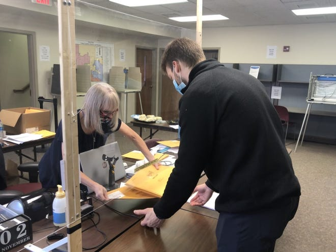 Jonah Devries, 26, requests nine absentee ballots for hospital patients at Sanford Health Tuesday, Nov. 3, 2020.