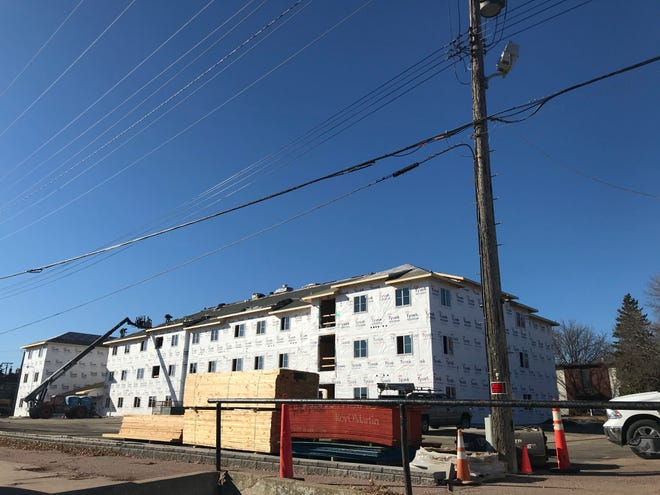 Crews make progress on the Irving Center apartment building at the intersection of 11th Street and Spring Avenue in Sioux Falls. Lloyd Companies hopes to start leasing units this spring.