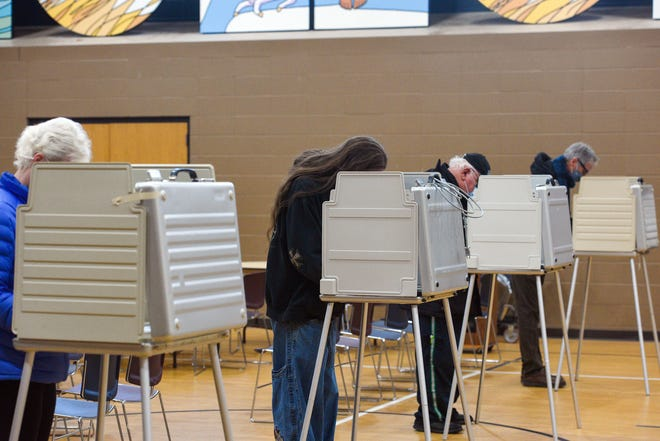 People stand at voting booths on Election Day on Tuesday morning, November 3, at First Lutheran Church in Sioux Falls.