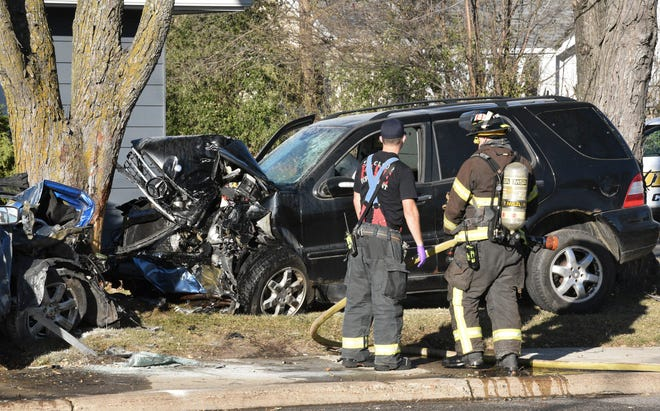 The St. Cloud Fire Department assesses the damage after a two-vehicle crash shut down a section of Veterans Drive across from Centennial Plaza Tuesday, Nov. 3, 2020, in St. Cloud.