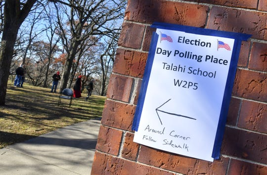 A sign directs voters to the polling place Tuesday, Nov. 3, 2020, at Riverside Park in St. Cloud.