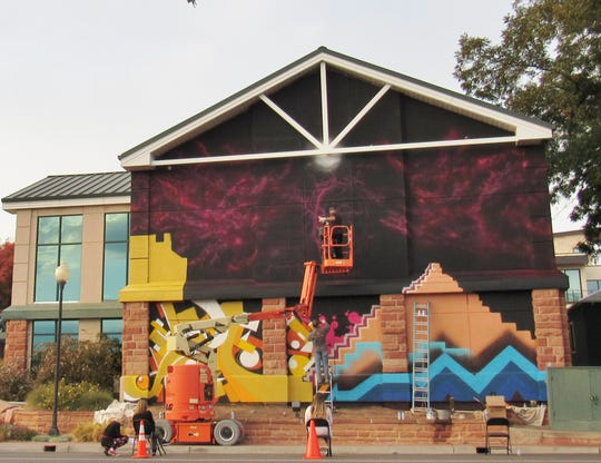 A mural painting by street artist Desi Mundo and his crew is going up along the south-facing wall of the St. George Art Museum. City officials said the project could be done by Tuesday evening. The museum celebrated the 30th anniversary of its opening on Tuesday.