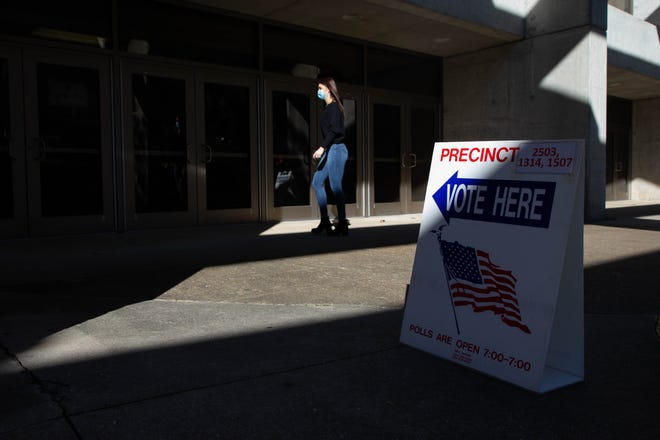 A voter enters the polling place at Donald L. Tucker Civic Center on Election Day Tuesday, Nov. 3, 2020.