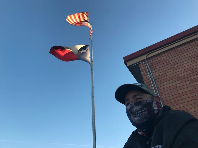 George Chavez, 42, said he approves of President Donald Trump's handling of the economy and planned to vote for him again. He waited in line at Fire Station No. 7 in El Paso before the polls opened at 7 a.m. on Election Day, Nov. 3, 2020.