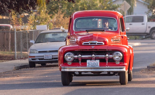 Christopher Pope drives a '51 Ford pickup on Monday, November 2, 2020 to make contact with registered voters. Pope is a candidate for Visalia Unified School Board, Area 6. The pickup was restored by his late father and carries his campaign sign.