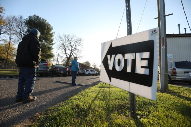 Voters wait their turn outside the Zanesville Civic League Community Center on Tuesday. Despite a more than one-third of eligible voters in Muskingum County voting early, Election Day still saw plenty of in-person voting.