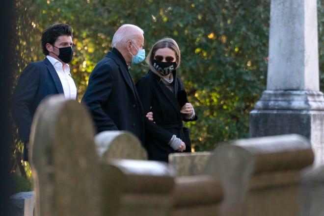 Democratic presidential candidate former Vice President Joe Biden walks with his granddaughter Finnegan Biden into St Joseph On the Brandywine Catholic Church in Wilmington, Delaware, on Election Day.