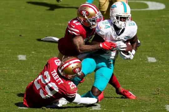 Miami Dolphins Isaiah Ford (84) face strong corner defender Jaquiski Tartt (29) of San Francisco 49ers, Jamar Taylor (47) in the first half of NFL football match in Santa Clara, California, Owner October 11, 2020.