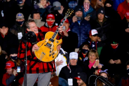 Ted Nugent plays the national anthem before the start of US President Donald Trump's Make America Great Again rally during the 2020 US presidential campaign at Gerald R. Ford International Airport on November 2, 2020 , in Grand Rapids, Michigan.