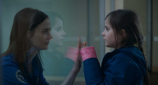 "A French astronaut (Eva Green, left) juggles her dream of reaching space with the responsibility of caring for her daughter (Zélie Boulant-Lemesle) in ""Proxima."""