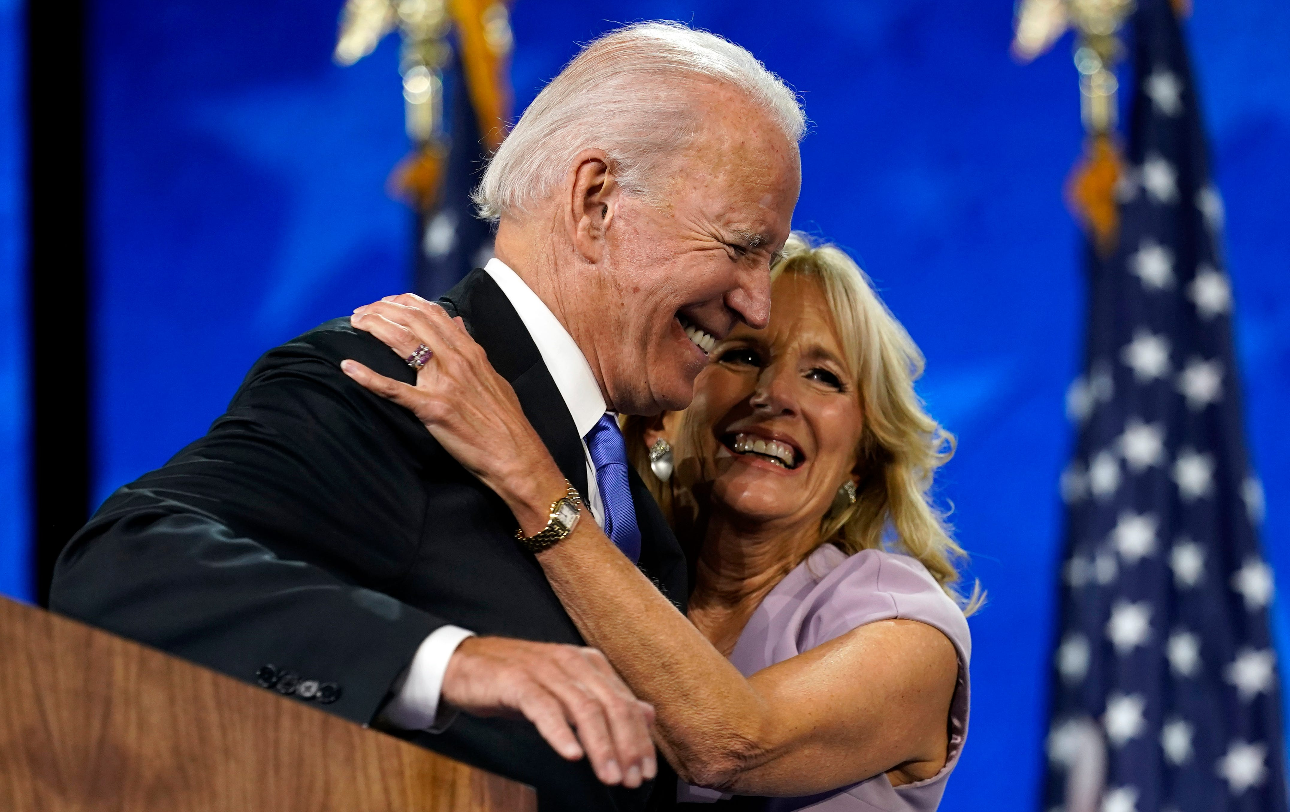 Democratic presidential candidate former Vice President Joe Biden hugs his wife Jill Biden after his speech during the fourth day of the Democratic National Convention, Thursday, Aug. 20, 2020, at the Chase Center in Wilmington, Del.