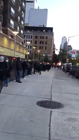 Voters in Manhattan wait in long lines to cast their ballots on Election Day