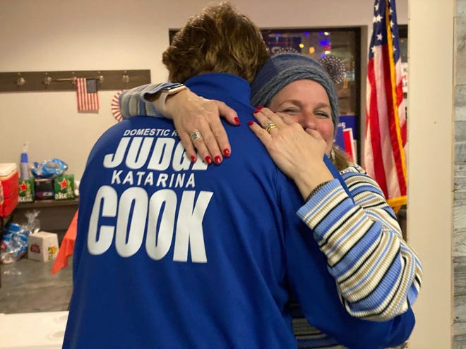 Katarina Cook, who won a Summit County Domestic Relations Court seat, hugs her son Christian Cook at the election night party at the Hudson Republican Victory Center.