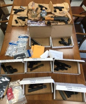 Akron police seized a dozen guns in three traffic stops this past Friday.