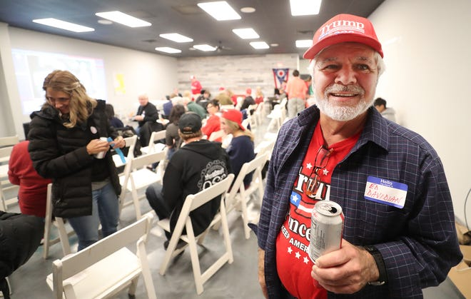 Ed Davidian, a Trump campaign volunteer, relaxes with a Diet Coke at a watch party at the Hudson Republican Victory Center on Tuesday.