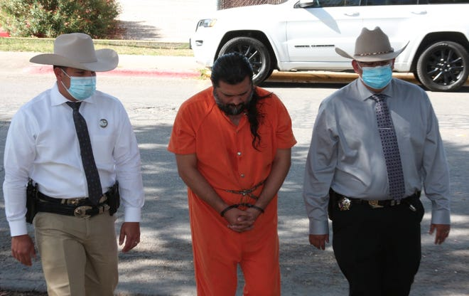 Mauricio Jesus Ruiz (middle) was arrested by Investigators on an aggravated sexual assault of a child.