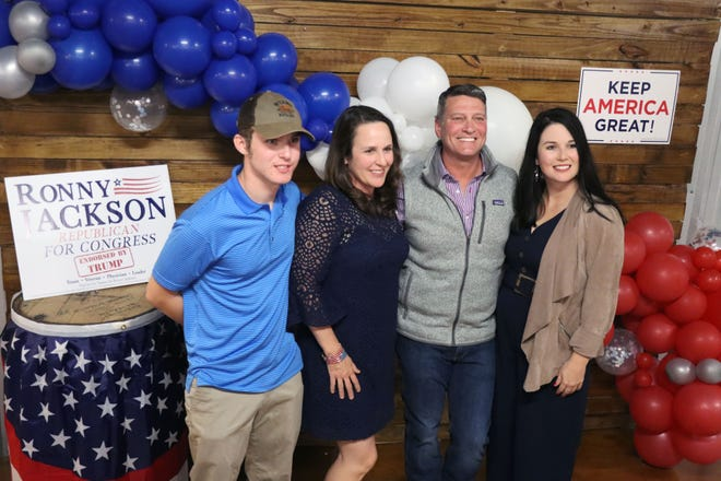 The Jackson family, Matthew, Jane, Ronny and Libby pose for pictures as they celebrate Ronny Jackson's victory in the race for the to represent Texas' 13th Congressional District in the United States House of Representatives.  [Neil Starkey / For the Amarillo Globe-News]