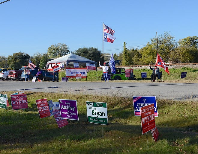 Anna candidates greet supporters on Election Day.