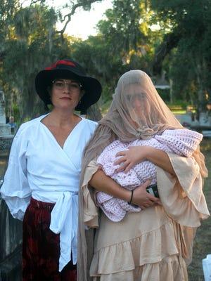 Regina Flatauer (Tina Robertson), and daughter Freda, (Cassandra Robertson),