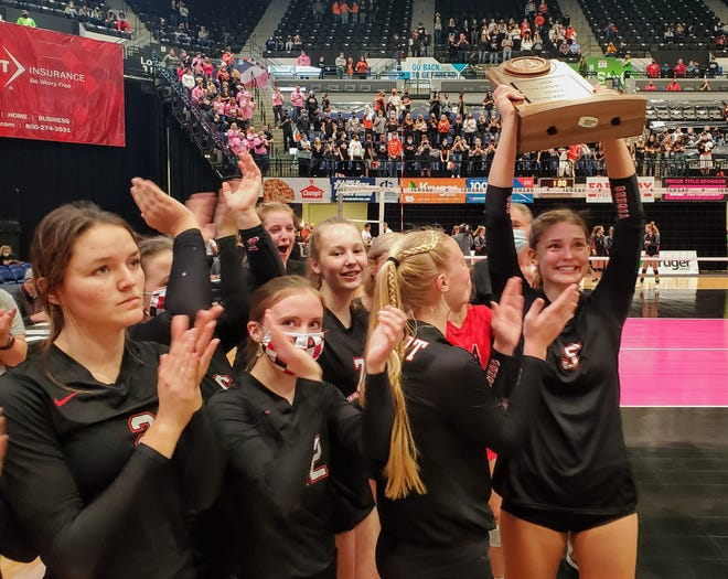 Gilbert's Thea Rotto holds up the Tigers' state semifinalist trophy after the Tigers fell to West Delaware in three sets during the Class 4A semifinals of the state volleyball tournament Wednesday in Cedar Rapids. Gilbert ended the season at 27-10.