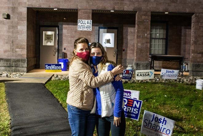 Beverly Campeau and her daughter, Taylor, hug outside the  Horsham Township Community Center after Beverly voted Tuesday evening. The two chose opposing candidates.