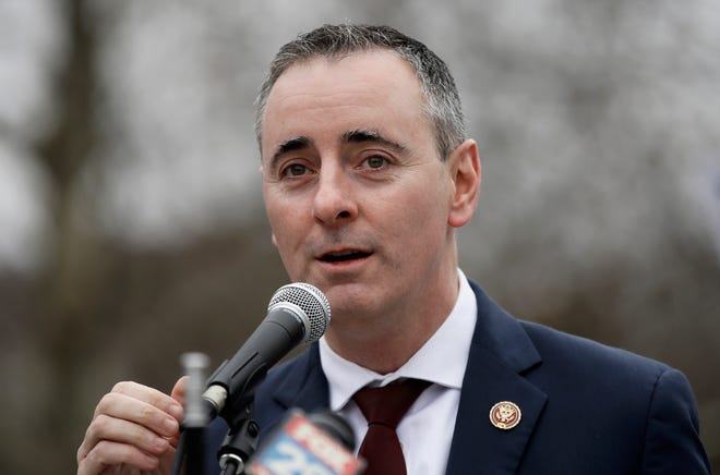 FILE - In this Jan. 8, 2019 file photo, Rep. Brian Fitzpatrick, R-Pa., in Pennsylvania's 1st U.S. Congressional District, speaks in Philadelphia during a demonstration. Fitzpatrick won re-election in 2020.